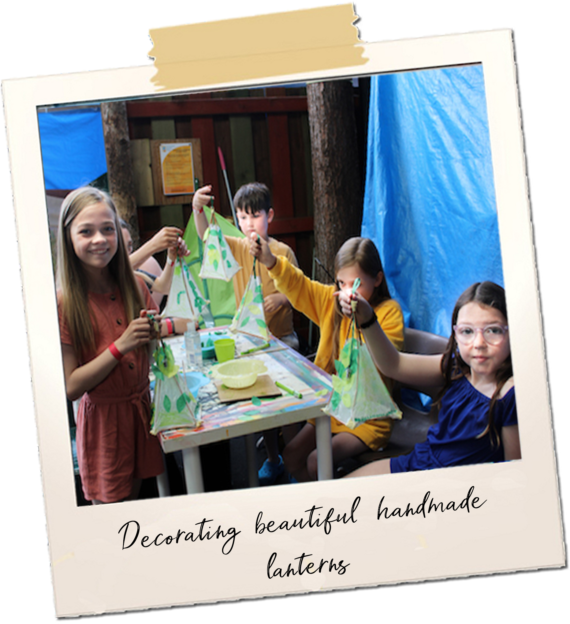 4 young people hold up handmade lanterns decorated with leaves